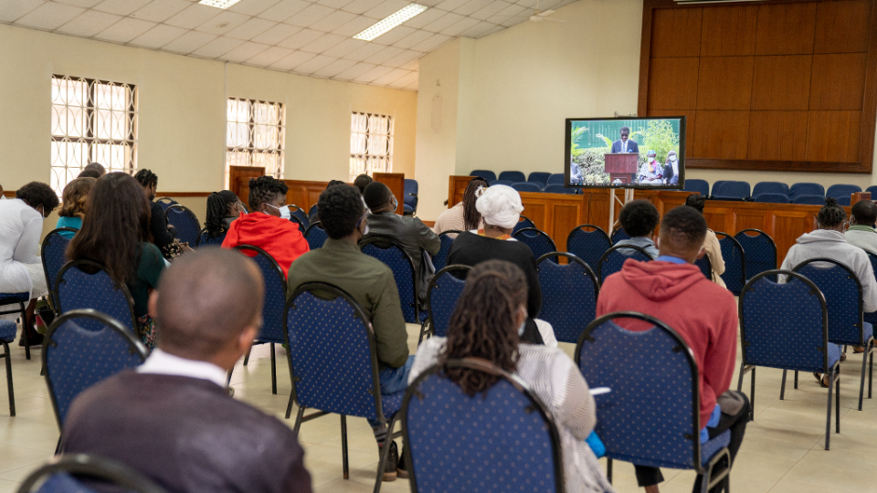 Members-of-the-Mountain-View-ward-watch-the-live-streaming-of-the-Nairobi-Kenia-breaking